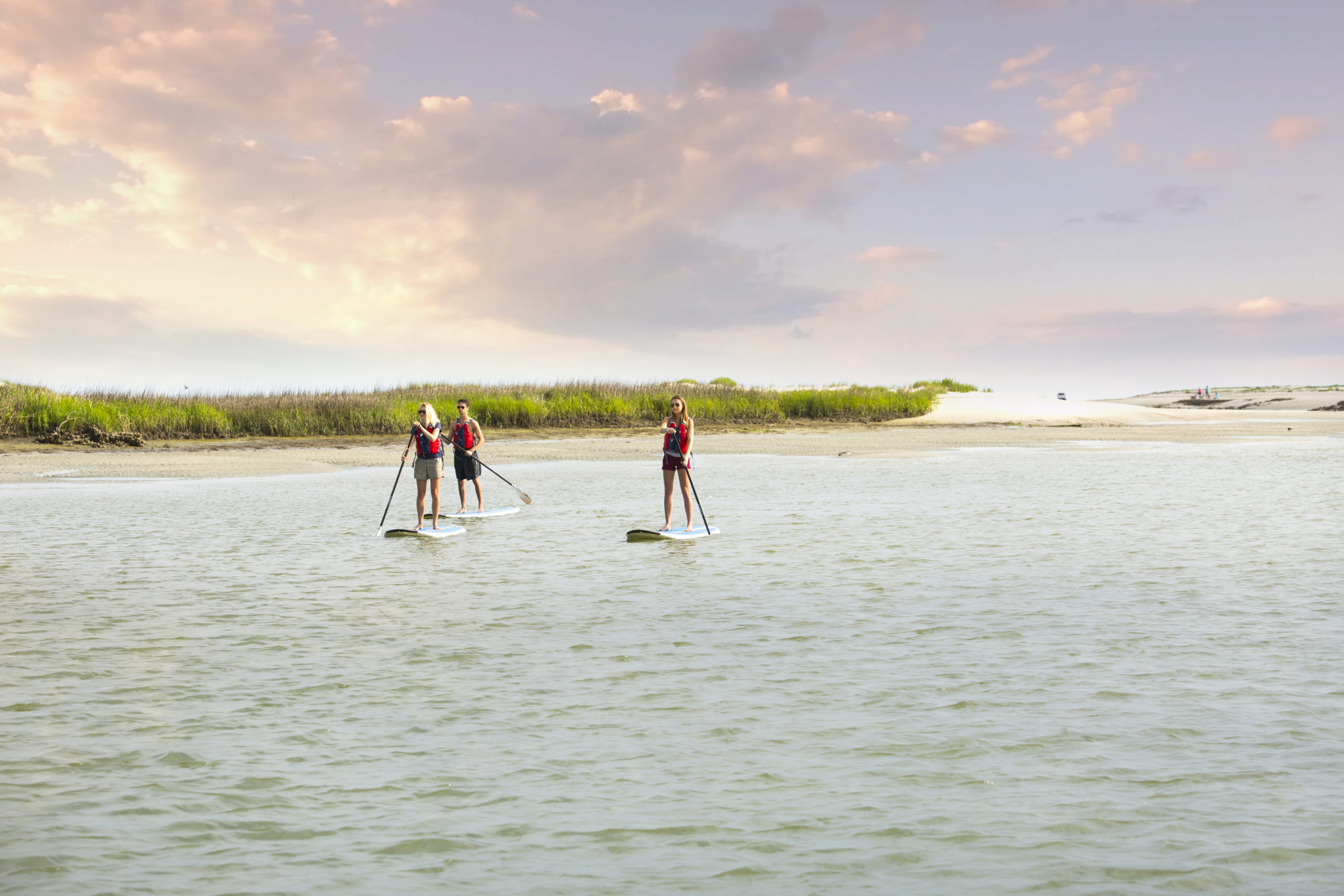 paddle boarders on the kiawah river